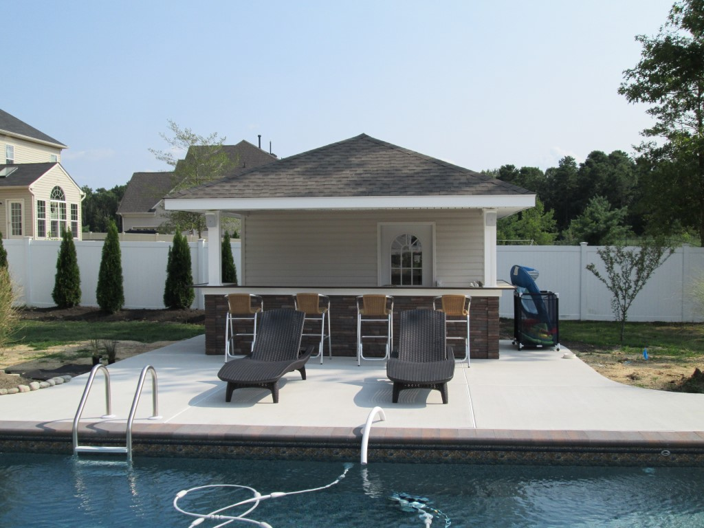 Tiki bars pool houses american sheds for Pool and pool house